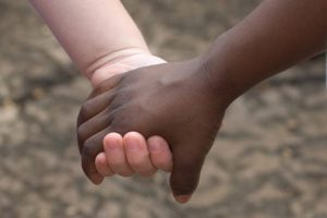 blacks_and_whites_holding_hands_stock_photo_167915